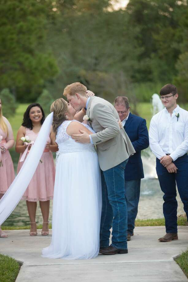 Chloe and Timothy Watterreus had planned to wed at her parents' home in Kingwood on Sept. 2, but the home was destroyed by Hurricane Harvey. After the storm, Morgan Falls Event Center in Alvin gave the couple their dream wedding on Oct. 7. Photo: Morgan Falls Event Center