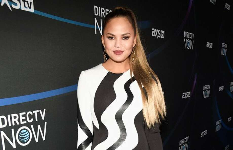 """PHOTOS: Chrissy Tegien' through the years ...Chrissy Teigen is mourning the loss of a furry family member on Wednesday. """"Lip Sync Battle"""" personality Teigen took to social media on Wednesday to alert fans that her dog Puddy had died, noting, """"My heart aches."""""""