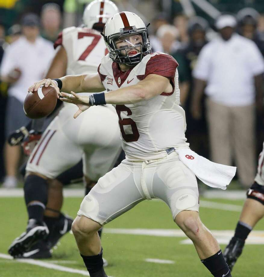 Oklahoma quarterback Baker Mayfield is a Heisman Trophy candidate and directs one of college football's premier offenses. Photo: Associated Press /