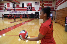Westfield senior Tylar Dortch sets to serve during a team scrimmage at a team practice at Westfield High School on Oct. 12, 2017. (Photo by Jerry Baker/Freelance)