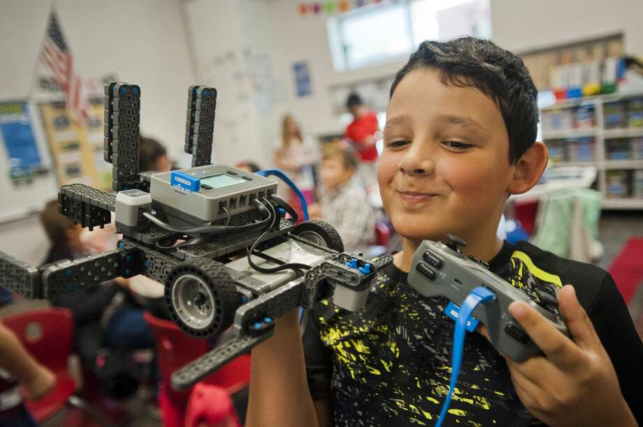 Alex Posch of Midland, 9, shows off a robot he is experimenting with along with his Central Park Elementary classmates on Friday. Donors to the school, which has a STEM focus, were able to tour the facility and observe classrooms during an open house event that took place Friday, Oct. 12, 2017. (Katy Kildee/kkildee@mdn.net) Photo: (Katy Kildee/kkildee@mdn.net)