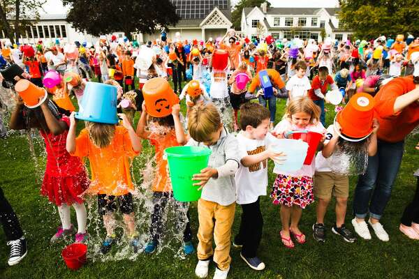 Greenwich Country Day School 5th graders, along with the rest of the school, participate in an attempt to set the Guiness Book of World Record's largest ALS Ice Bucket Challenge at the Greenwich Country Day School in Greenwich, Conn. on Friday, October 13, 2017. The Ice Bucket Challenge is part of the GCDS's annual walkathon. The Walkathon is an all-school effort to raise support for charities. This year they will be raising funds for ALS research and care. One dollar was donated to the cause for every ice bucket.