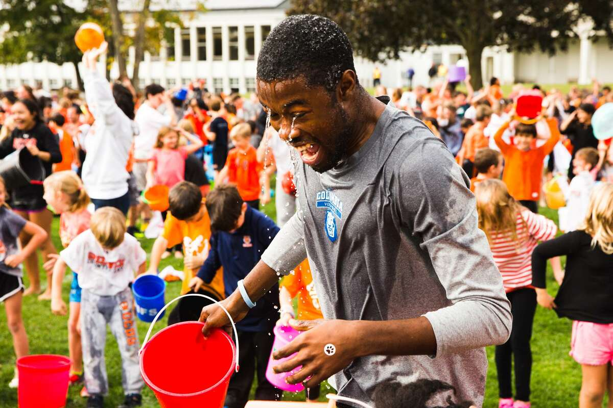 Kindergarten teacher Nicolas Edwards, along with the rest of the school, participates in an attempt to set the Guiness Book of World Record's largest ALS Ice Bucket Challenge the at the Greenwich Country Day School in Greenwich, Conn. on Friday, October 13, 2017. The Ice Bucket Challenge is part of the GCDS's annual walkathon. The Walkathon is an all-school effort to raise support for charities. This year they will be raising funds for ALS research and care. One dollar was donated to the cause for every ice bucket.