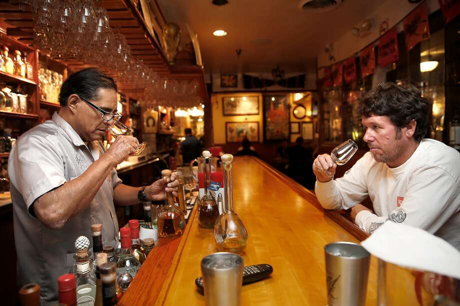Julio Bermejo (left) does a tasting of vintage and new Corazon Tequila with Kevin Fealy at Tommy's Mexican Restaurant. Photo: Liz Hafalia, The Chronicle