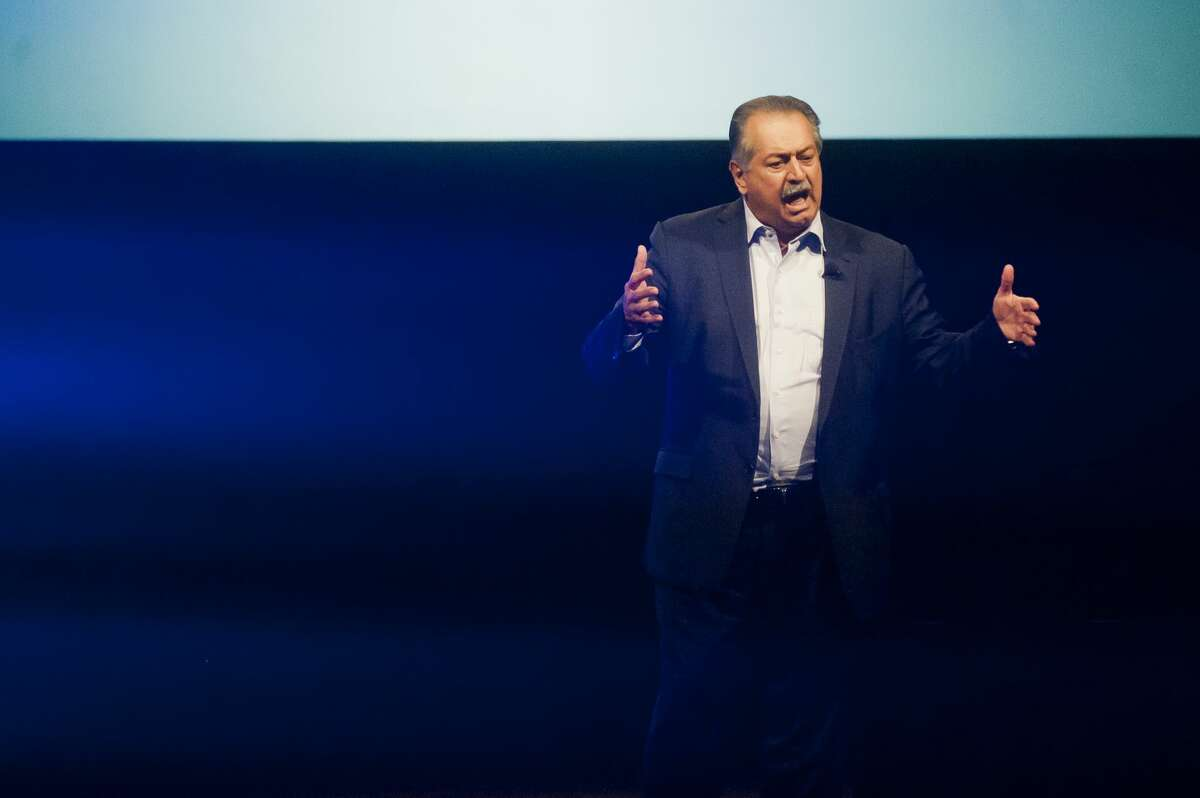 Dow CEO Andrew Liveris speaks to about 400 H. H. Dow and Midland high school students in Central Park Elementary auditorium during the
