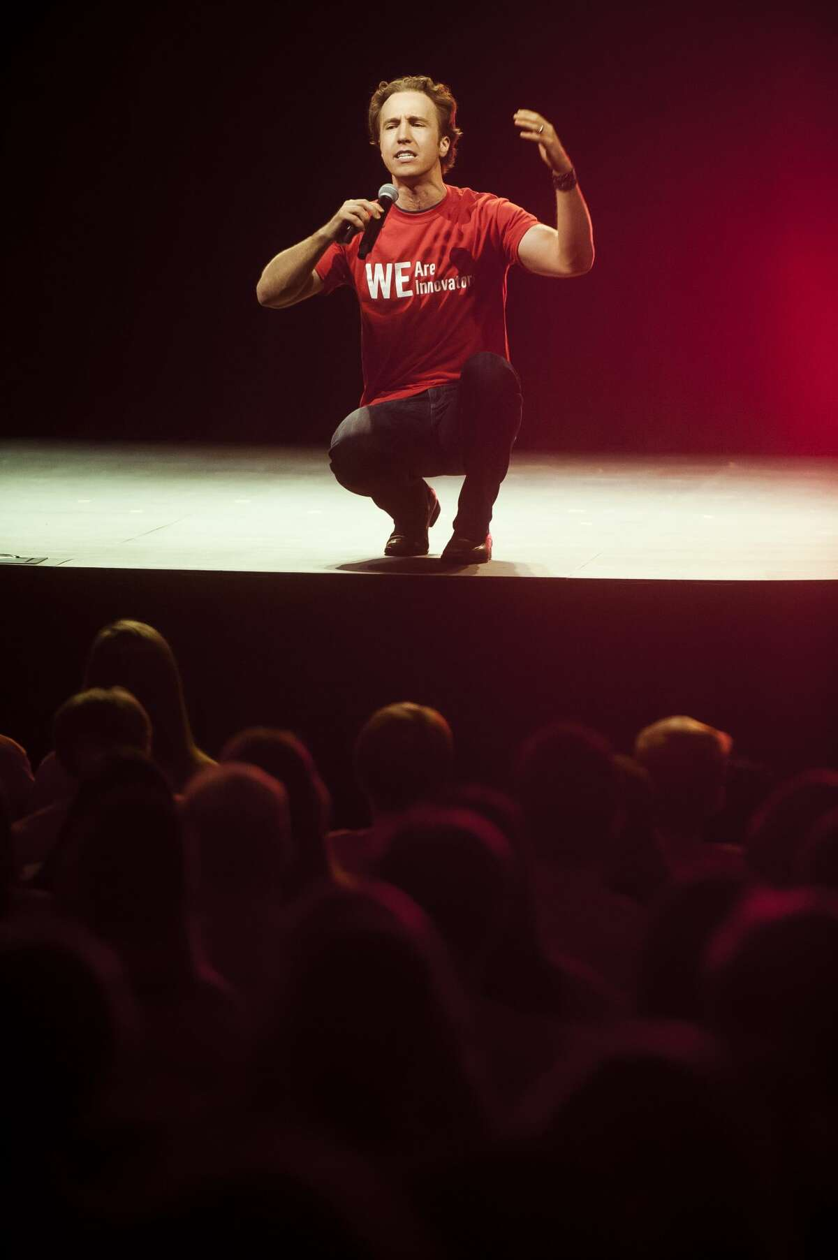WE cofounder Craig Kielburger speaks to about 400 H. H. Dow and Midland high school students in Central Park Elementary auditorium during the