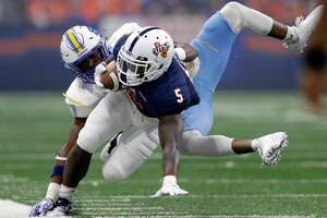 UTSA running back Jalen Rhodes (5) is hit by Southern defensive back Andrea Augustine during the first half of an NCAA college football game, Saturday, Sept. 16, 2017, in San Antonio.