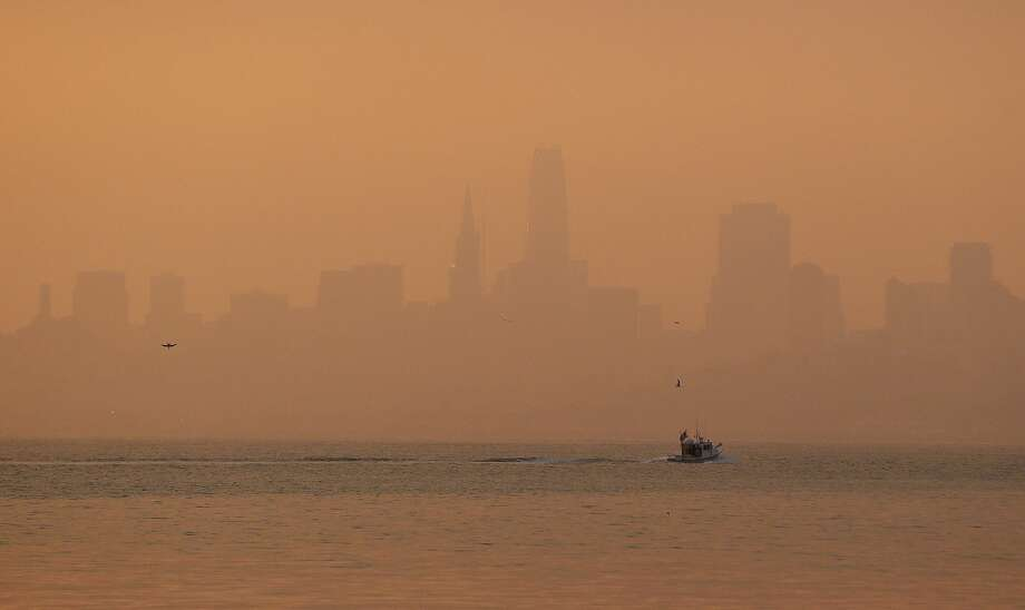 The San Francisco skyline is obscured by smoke and haze from wildfires Thursday, Oct. 12, 2017, in this view from Sausalito. San Franciscans woke to the smell of smoke Monday morning as a light sooty haze blanketed the Bay Area. Photo: Eric Risberg/AP