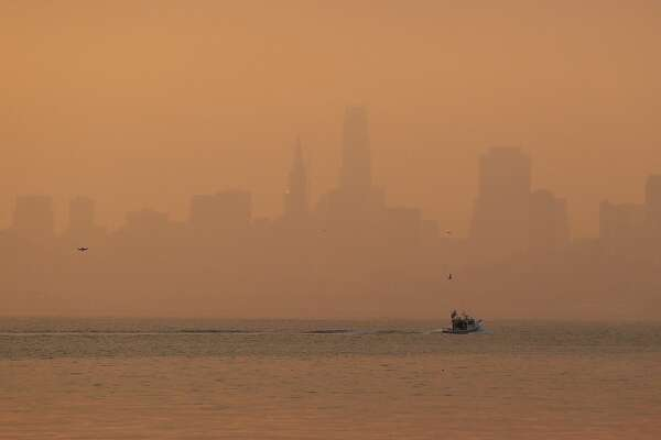 The San Francisco skyline is obscured by smoke and haze from wildfires Thursday, Oct. 12, 2017, in this view from Sausalito, Calif. Gusting winds and dry air forecast for Thursday could drive the next wave of devastating wildfires that are already well on their way to becoming the deadliest and most destructive in California history. (AP Photo/Eric Risberg)