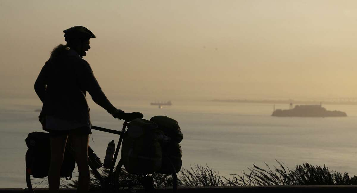 A visitor gets a view of the San Francisco Bay, including Alcatraz Island, at right, as smoke from wildfires fills the morning air Friday, Oct. 13, 2017, in San Francisco. (AP Photo/Marcio Jose Sanchez)