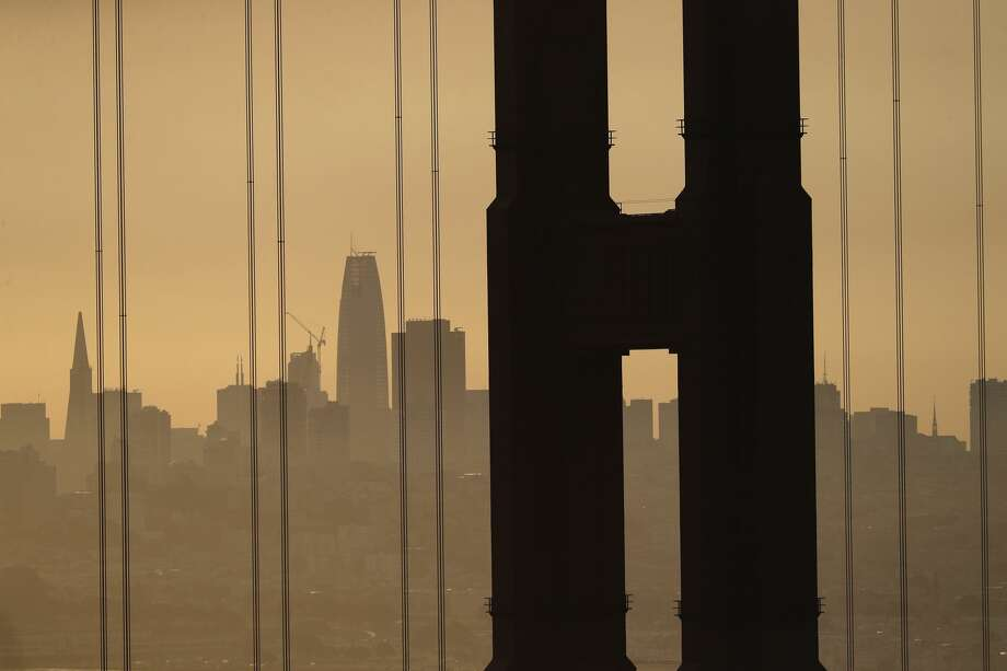 Smoke from wildfires fills the morning air in a view of San Francisco through the Golden Gate Bridge from the Marin Headlands Friday, Oct. 13, 2017, in San Francisco.  (AP Photo/Marcio Jose Sanchez) Photo: Marcio Jose Sanchez/AP