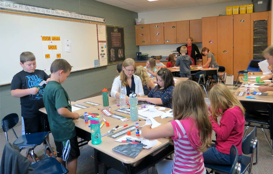 Kim Roughley works with her class on her first day as a second-grade teacher at Laker Elementary School. Photo: Submitted To The Tribune