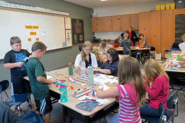 Kim Roughley works with her class on her first day as a second-grade teacher at Laker Elementary School.