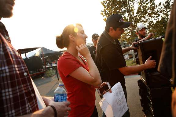 Christina Sanchez (l to r) and Vince Sanchez, co-owner Woodhouse Barbeque, help coordinate a donation of meals going out to an evacuation center at the Napa Valley College on Thursday, October 12, 2017 in Napa, Calif. Operation BBQ Relief, connects thousands of volunteers from the competitive barbecue circuit, has served close to 1.7 million meals in 23 states since its founding in 2011, most recently in hurricane-ravaged Texas and Florida.
