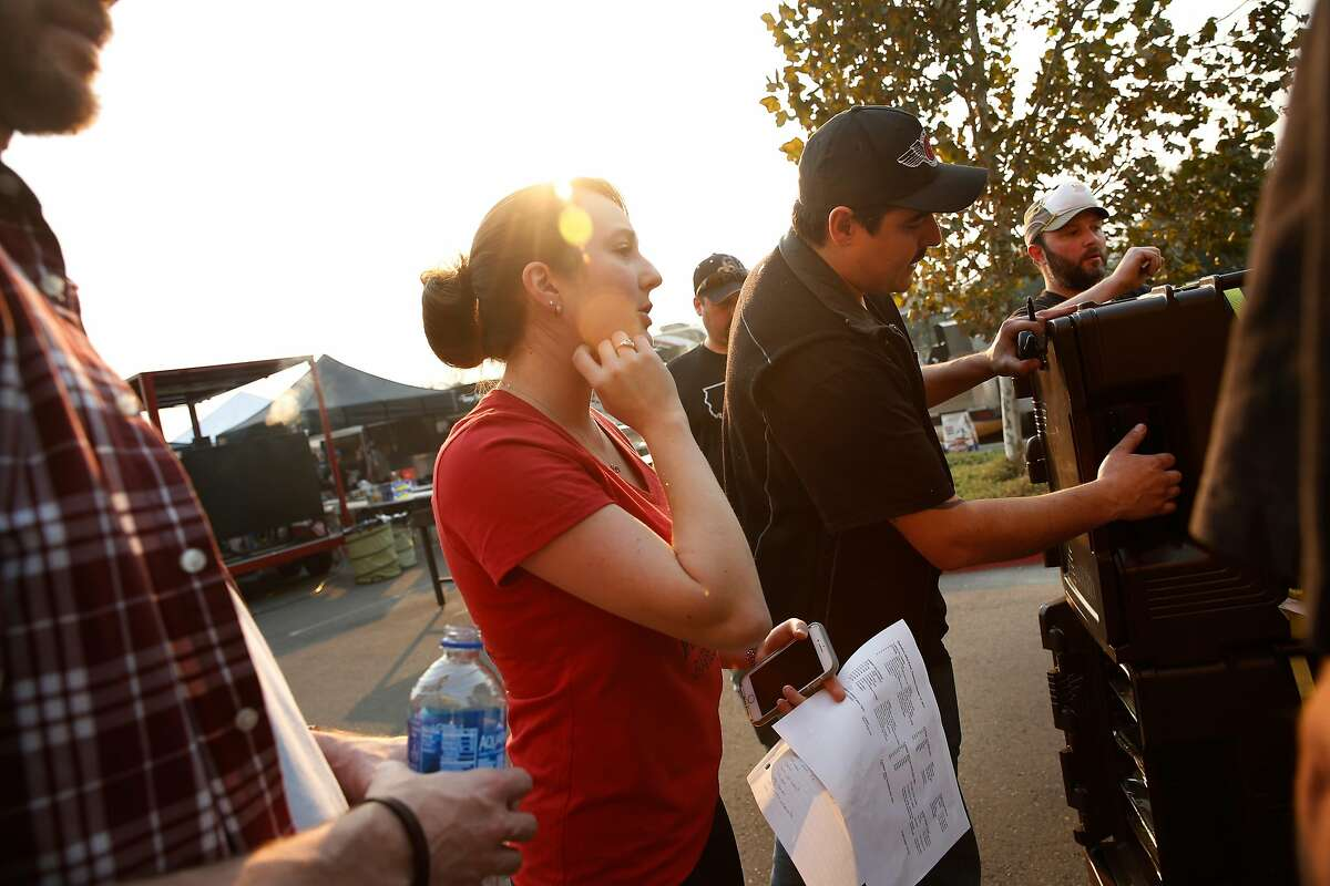 Christina Sanchez and Vince Sanchez, co-owners of Woodhouse Barbecue, help coordinate a donation of meals going out to an evacuation center at the Napa Valley College on Thursday, Oct. 12, 2017 in Napa.