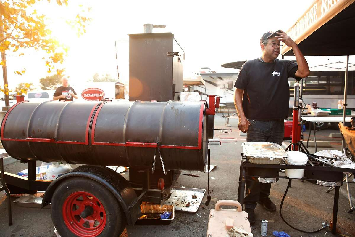 Woody Sims, owner Woody Sims Barbecue, works near his grill at an Operation BBQ Relief site on Thursday, Oct. 12, 2017 in Napa.