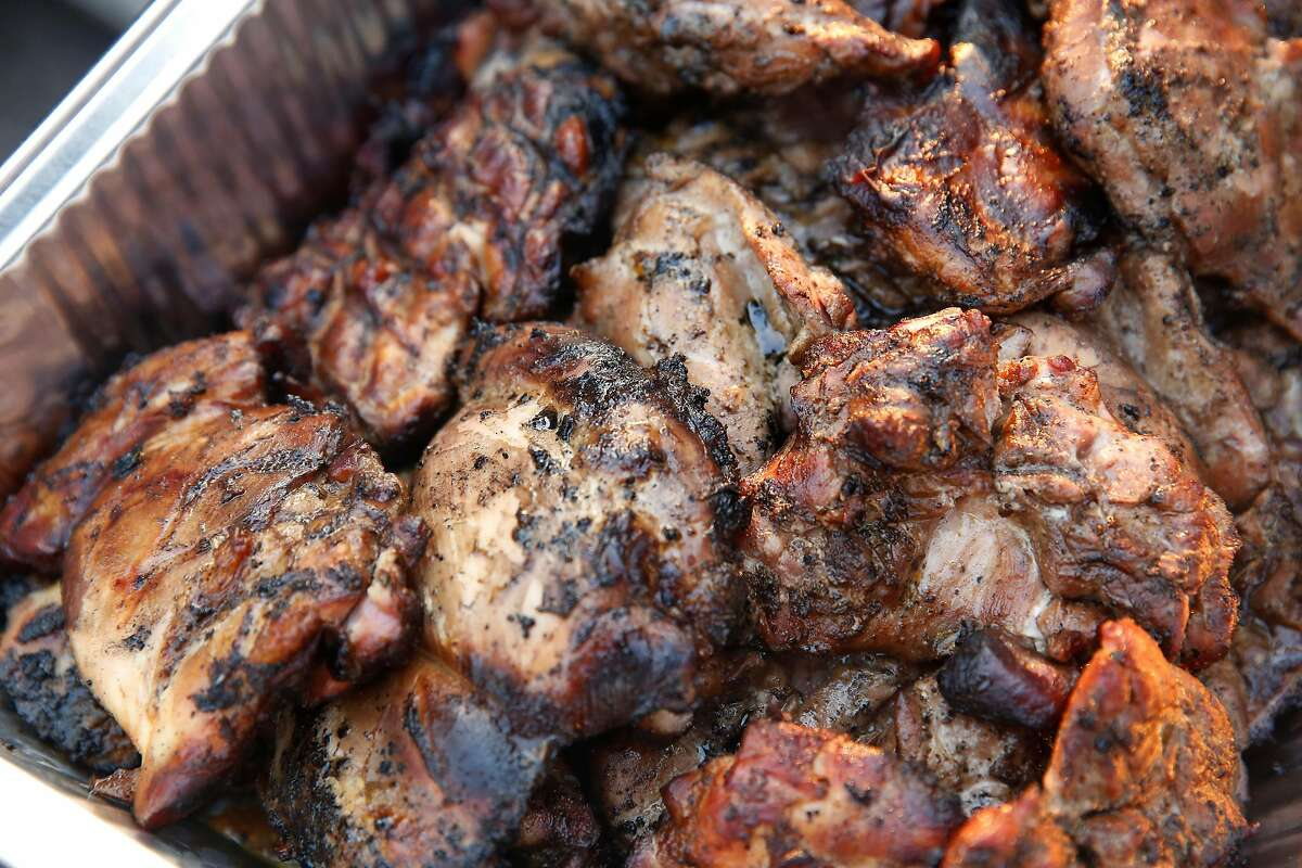 A tray filled with barbecued chicken to be donated for meals is seen at an Operation BBQ Relief site on Thursday, Oct. 12, 2017 in Napa.