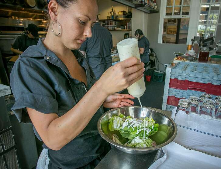 Chef Melissa Perfit dresses the Butter Lettuce Salad at Hard Water in San Francisco, Calif., on Friday, May 3rd, 2013.