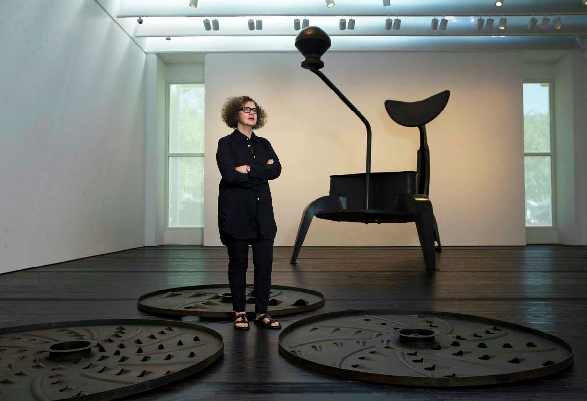 """MonaHatoumstands inside the Menil Collection where she has an exhibition, including her sculpture """"La Grande Broyeuse (Mouli-Julienne x 17),"""" Wednesday, October 11, 2017. The sculpture is part of the exhibition """"Terra Infirma"""" that will be on display Oct. 13 through Feb.15. (Mark Mulligan / Houston Chronicle)"""