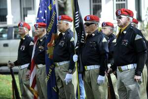 New Milford Veterans Honor Guard participate in New Milford's annual Veterans Day ceremony on the New Milford Green, Friday, Nov. 11, 2016