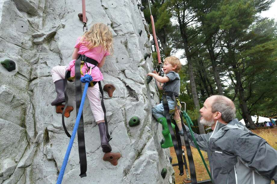 Fairfield's Scott Harrington helps his family climb the rock wall during Earthplace Festival at Earthplace nature center on Sunday October 8, 2017 in Westport Conn. Photo: Alex Von Kleydorff / Hearst Connecticut Media / Norwalk Hour