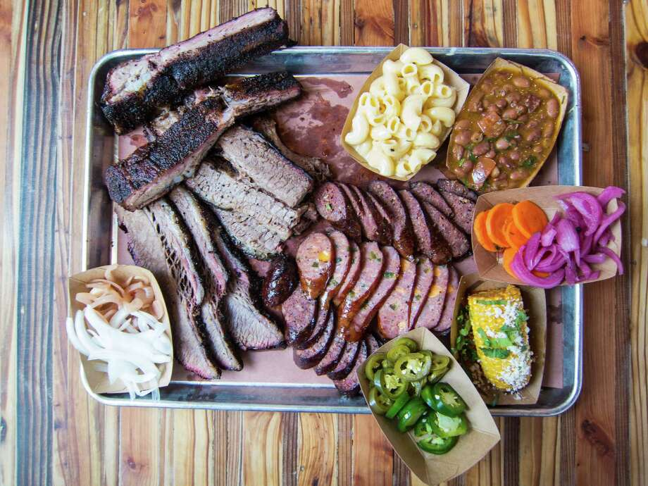 Brisket, pork ribs, sausage and sides at The Pit Room Photo: J.C. Reid