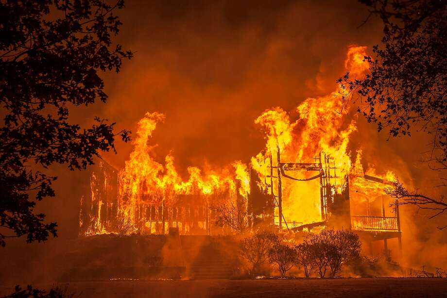 Fire totally engulfed the main structure at the Paras Vineyards as fire from the Nun Fire continue to burn west of downtown Napa, California, USA 10 Oct 2017. Photo: Peter DaSilva, Special To The Chronicle