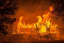 Fire totally engulfed the main structure at the Paras Vineyards as fire from the Nun Fire continue to burn west of downtown Napa, California, USA 10 Oct 2017.