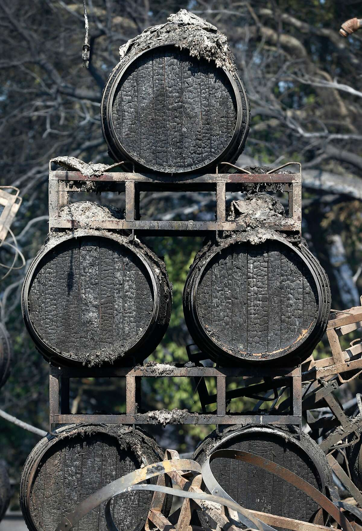 Wine barrels are charred at the Paradise Ridge Winery in Santa Rosa, Calif. on Thursday Oct. 12, 2017 after the Tubbs Fire destroyed the property but spared the vineyards.