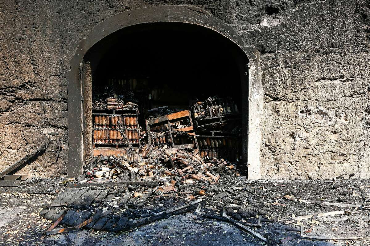 Hundreds of wine bottles are damaged and burned from inside the cellar at White Rock Vineyards in Napa, California on October 12, 2017