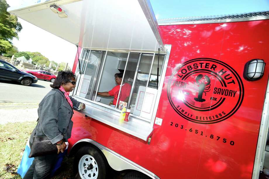 Debra Bond of Hamden orders a lobster roll at the Lobster Hut food truck at Whitneyville Cultural Commons in Hamden on October 13, 2017. Photo: Arnold Gold / Hearst Connecticut Media / New Haven Register