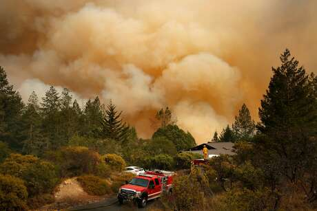 Sebastopol firefighters keep a close watch on a fire in the Oakmont neighborhood in Santa Rosa, Ca. on Tuesday October 10, 2017. Massive wildfires ripped through Napa and Sonoma counties, destroying hundreds of homes and businesses on Monday morning.
