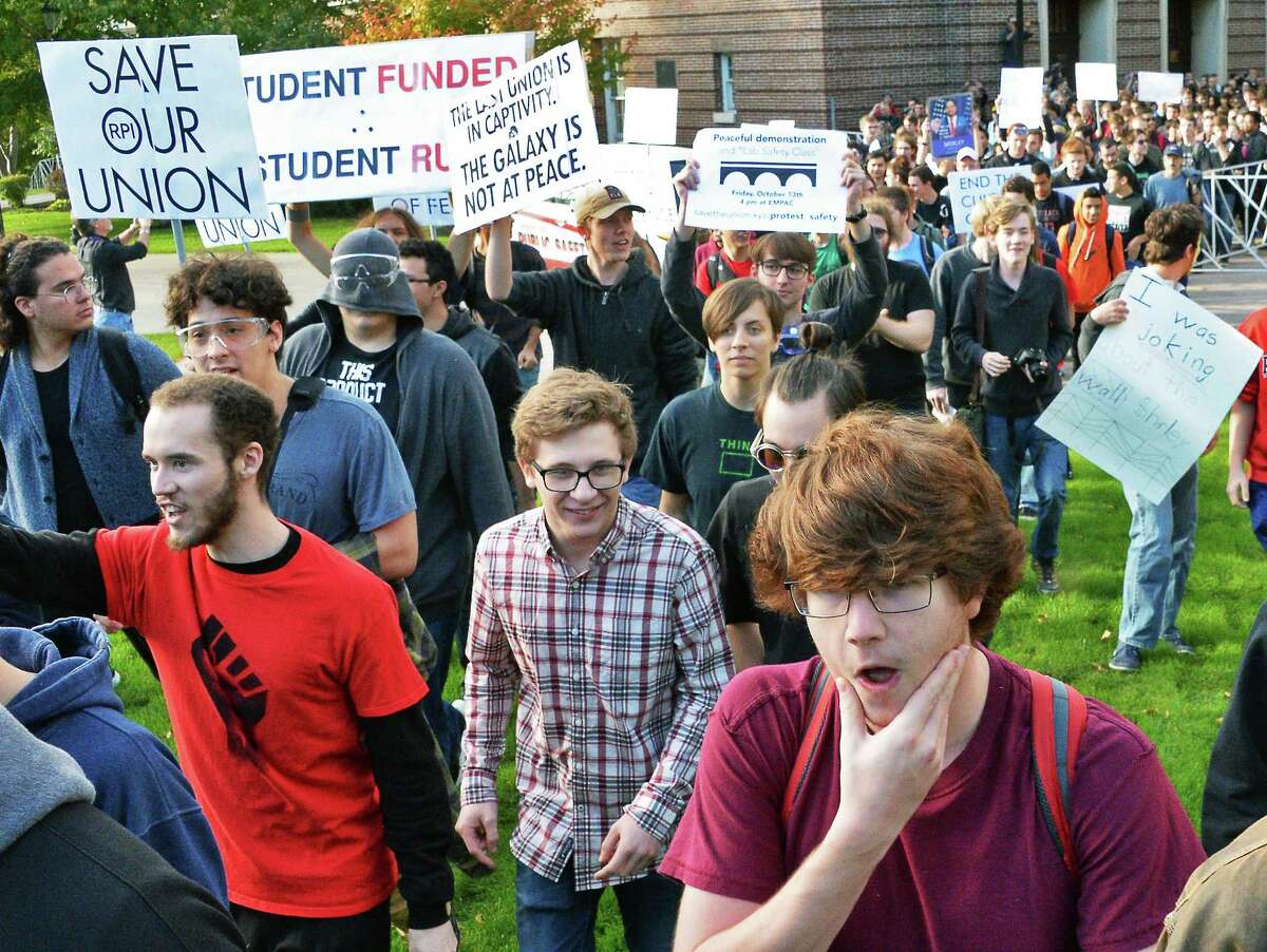 Student protesters pull down a barricade and stream out into campus as they demonstrate against the RPI administration over control of the student union Friday Oct. 13, 2017 in Troy, NY. (John Carl D'Annibale / Times Union)