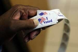 File photo of election stickers (AP Photo/Patrick Semansky)