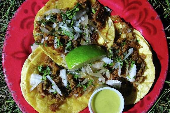 Crispy tripas mini-tacos on corn tortillas from the Taco Loco truck.