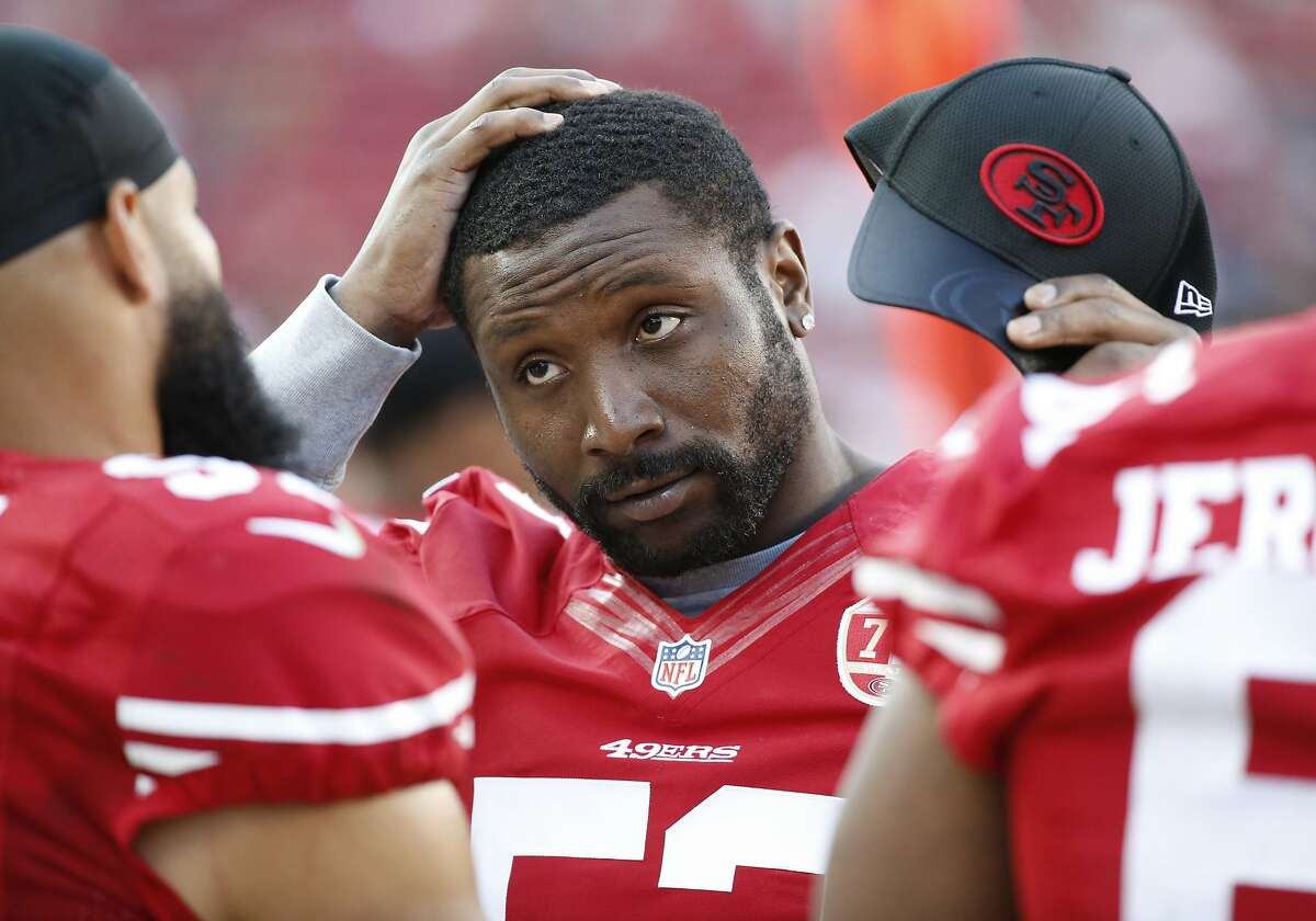 FILE - In this Aug. 14, 2016, file photo, San Francisco 49ers inside linebacker NaVorro Bowman standing on the sidelines during the second half of an NFL preseason football game in Santa Clara, Calif. The 49ers have released Bowman in a move that cut ties with one of the few remaining links from the team's last run of success. (AP Photo/Tony Avelar, File)