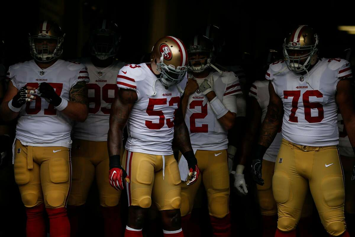 SEATTLE, WA - SEPTEMBER 17: San Francisco 49ers including NaVorro Bowman #53 of the San Francisco 49ers, Daniel Kilgore #67 of the San Francisco 49ers, DeForest Buckner #99 of the San Francisco 49ers, Brian Hoyer #2 of the San Francisco 49ers and Garry Gilliam #76 of the San Francisco 49ers wait to take the field before a game against the Seattle Seahawks at CenturyLink Field on September 17, 2017 in Seattle, Washington. The Seahawks won the game 12-9. (Photo by Stephen Brashear/Getty Images)
