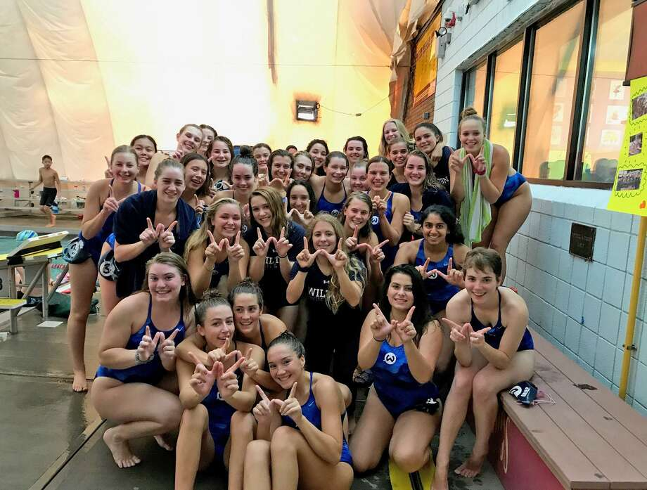 Members of the Wilton High girls swim team pose for a photo after defeating FCIAC power New Canaan by two points during a dual meet held last week at the Wilton YMCA. Photo: Contributed Photo / Hearst Connecticut Media / Norwalk Hour