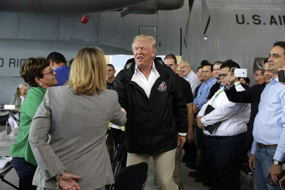 President Donald Trump shakes hands with San Juan Mayor Carmen Yulia Cruz during an awkward moment in San Juan, Puerto Rico. A reader accuses Trump of bullying the mayor. Photo: Evan Vucci /Associated Press / Copyright 2017 The Associated Press. All rights reserved.