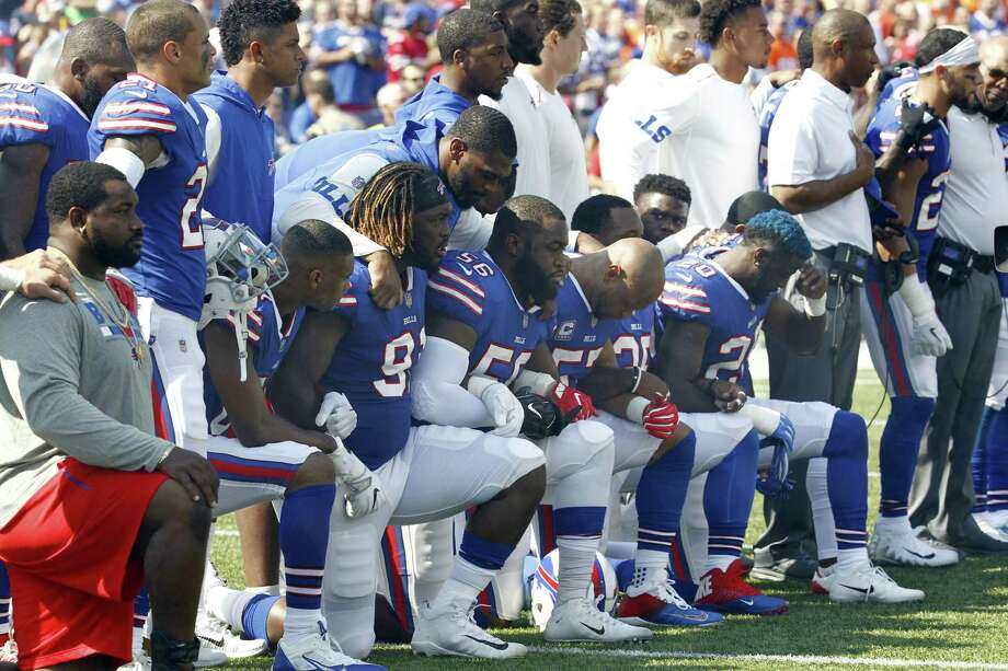 Some members of the Buffalo Bills kneel during the playing of the national anthem. The poem that started it all had an inauspicious debut more than 200 years ago. Photo: Jeffrey T. Barnes /Associated Press / FR171450 AP