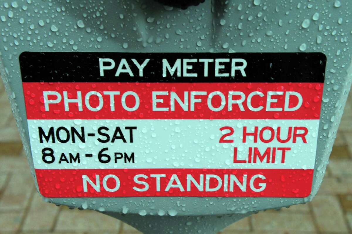 A sticker warns people parking of enforcement by photo along Main Street in Bridgeport.