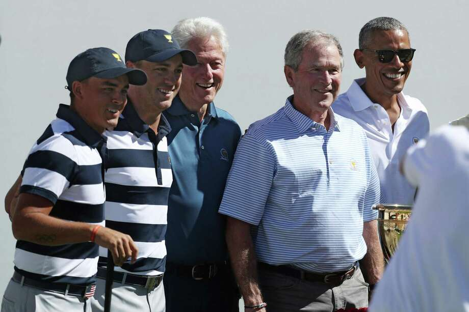 Rickie Fowler, left, and Justin Thomas of the U.S. Team pose with former Presidents Bill Clinton, George W. Bush and Barack Obama before the foursome matches of the Presidents Cup at Liberty National Golf Club in Jersey City, New Jersey. A reader appreciate the photo of the three ex-presidents, but … Photo: Rob Carr /Getty Images / 2017 Getty Images