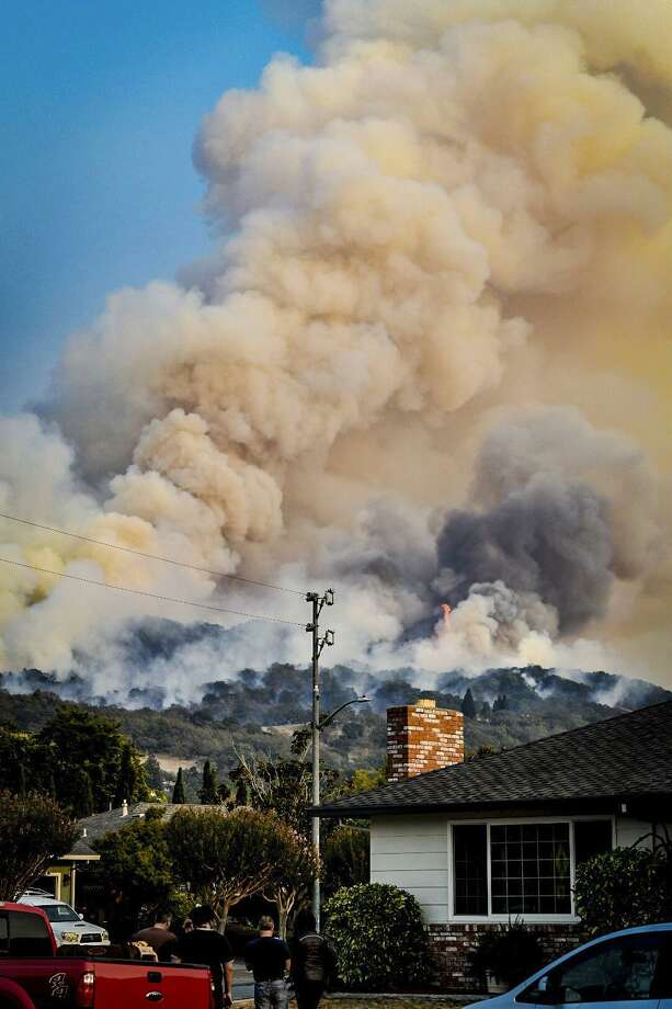 Smoke rises from fires Wednesday in Santa Rosa, Calif. Gusting winds and dry air have caused devastating wildfires that are already well on their way to becoming the deadliest and most destructive in California history. Photo: Derek Anderson /Associated Press / Derek Anderson