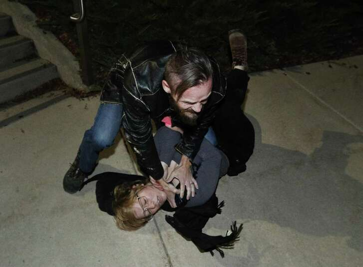 A counter protester takes down a protester after he was allegedly hit by her during a demonstration on the University of Utah campus at an event where writer and commentator Ben Shapiro was speaking on September 27.