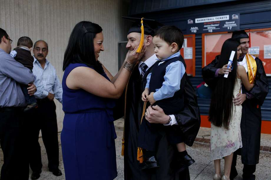 Such scenes as this must increase in Bexar County. Rising college graduation rates could be the most significant economic development project the county undertakes. Here, UTSA graduate Brian Ochoa celebrates with wife Jennifer Ochoa and their son, Ethan, in 2012. Photo: Express-News File Photo / © 2012 San Antonio Express-News