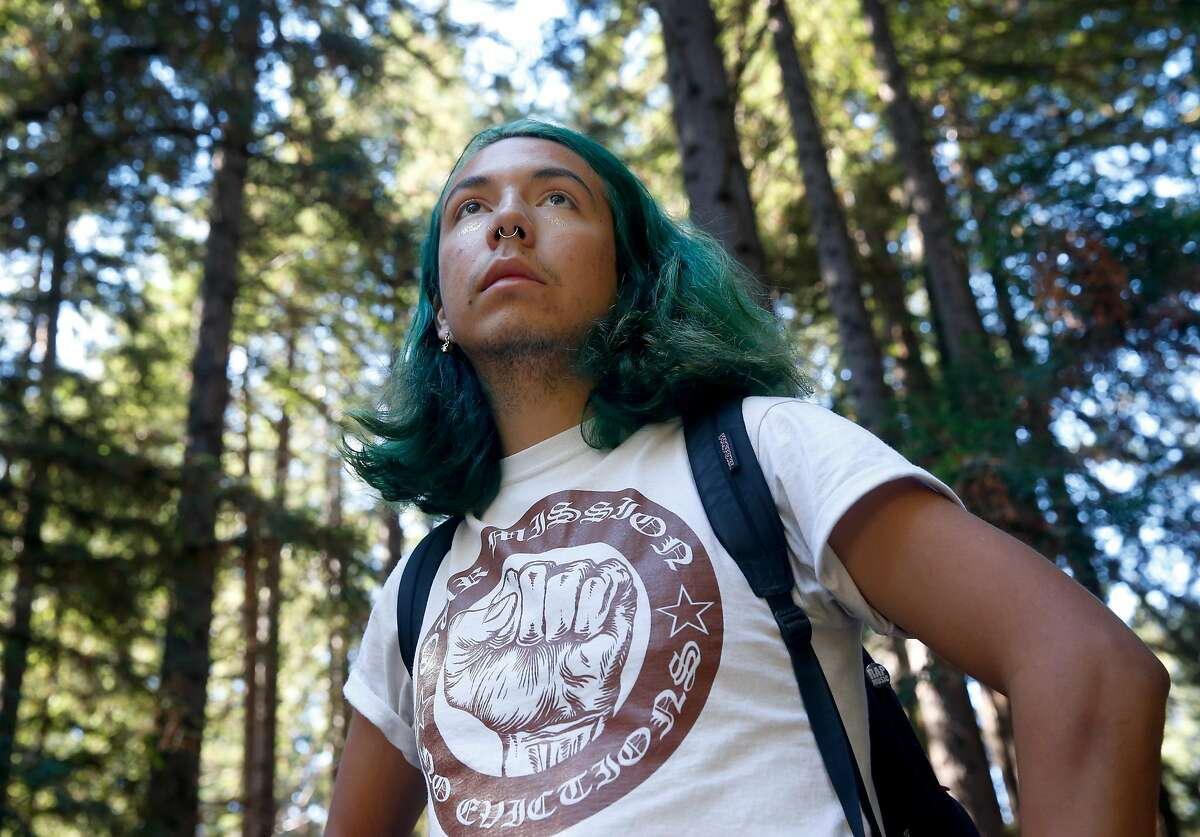 Enrique Yarce walks to his class on healthcare inequalities at UC Santa Cruz on Thursday Oct. 5, 2017. Yarce, who immigrated to the U.S. with his family when he was three years old and qualifies under the DACA act, is concerned about his uncertain future