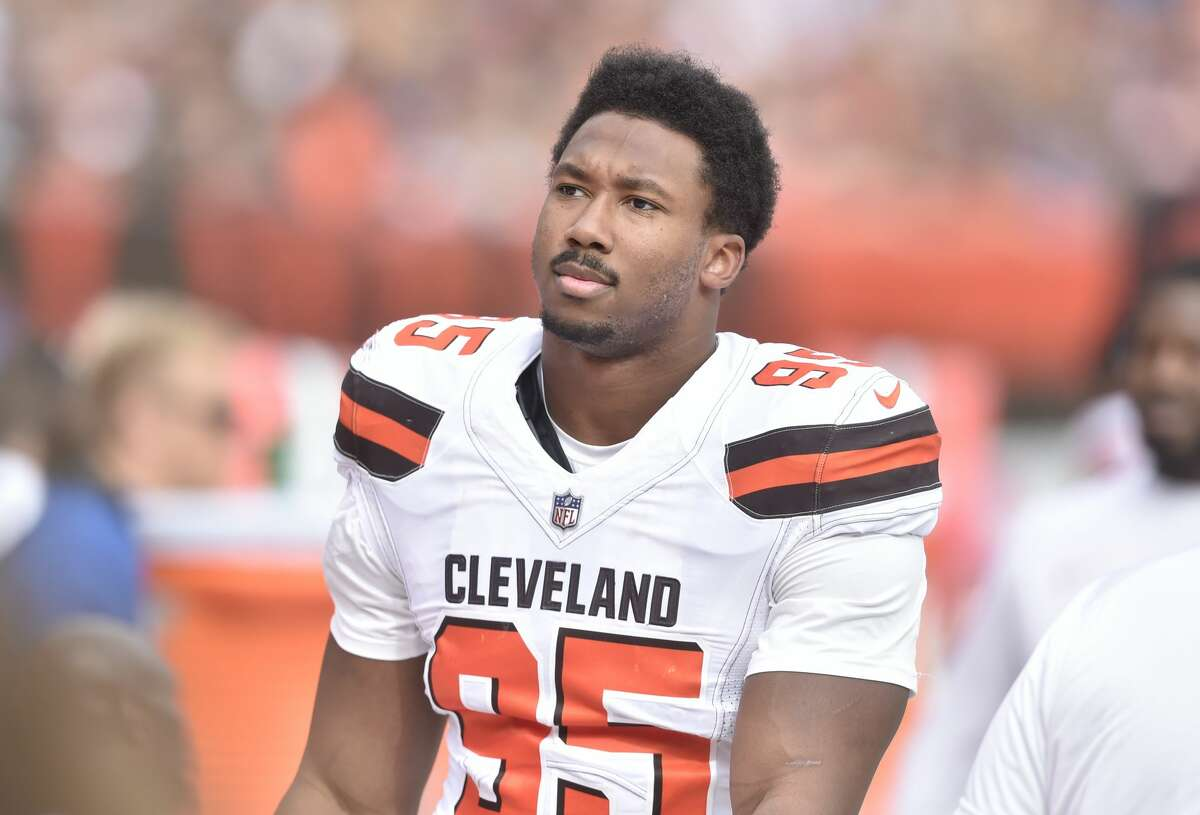 Cleveland Browns defensive end Myles Garrett (95) stands on the sideline during an NFL football game against the New York Jets, Sunday, Oct. 8, 2017, in Cleveland. The Jets won 17-14. (AP Photo/David Richard)