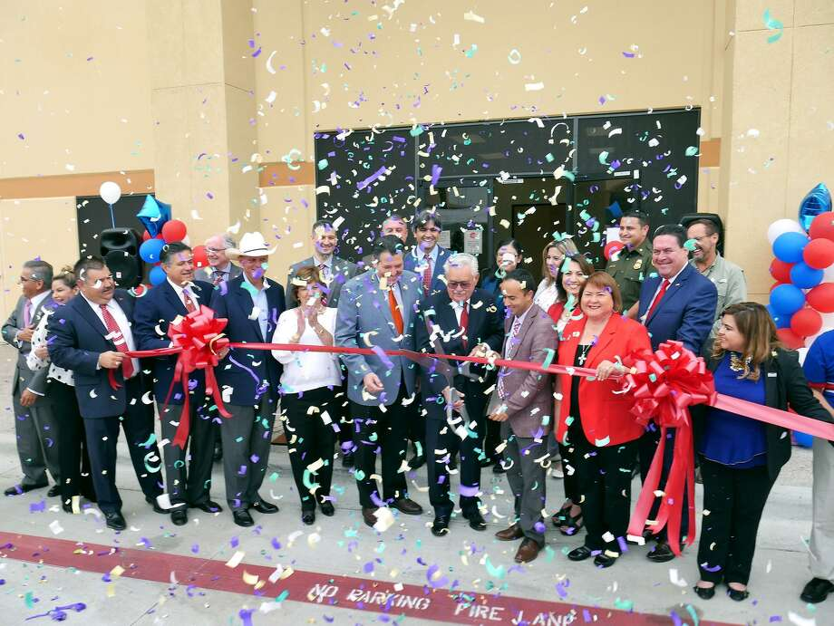 Local and state officials joined forces with Harmony Public Schools officials for the ribbon cutting ceremony for Laredo's newest high school, Harmony School of Excellence, Thursday, October 12, 2017. Photo: Cuate Santos / Laredo Morning Times / Laredo Morning Times
