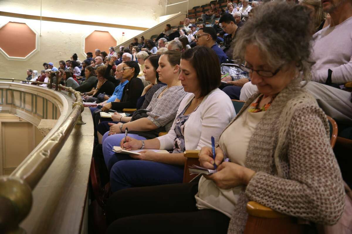 """Audience members take notes during the first panel of the New York Writers Institute's """"Telling the Truth in a Post-Truth World"""" symposium on Oct. 13, 2017, at the University at Albany."""