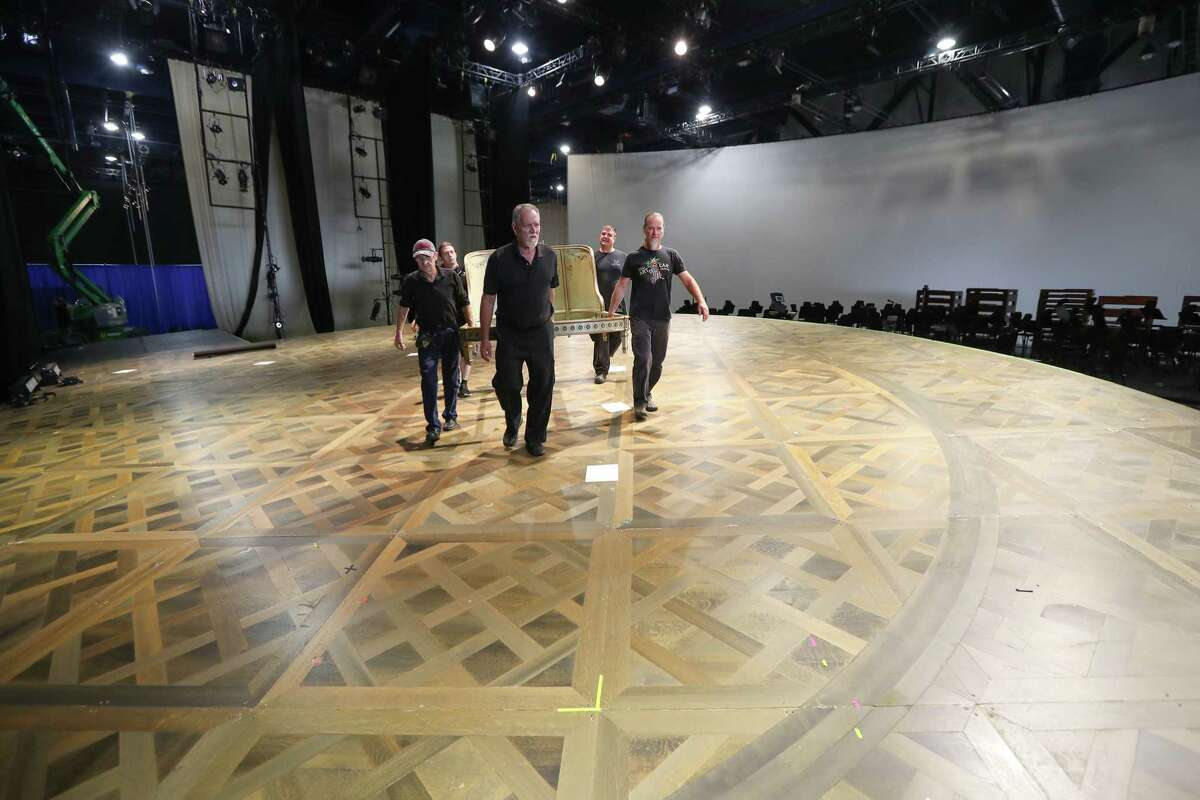 Stagehands move around sets during the transformation of a George R. Brown Convention Hall into a grand opera house is underway Wednesday, Oct. 11, 2017, in Houston. Houston Grand Opera moved to the George R. Brown Center Exhibition Hall A3, now titled the